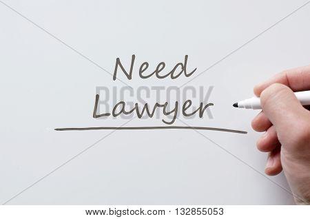 Human hand writing need lawyer on whiteboard