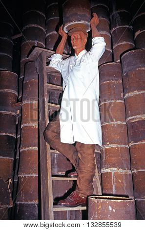 STOKE ON TRENT, UK - SEPTEMBER 10, 1997 - Statue of a working man climbing a ladder inside a bottle kiln at the Gladstone Pottery Museum Stoke on Trent Staffordshire England UK Western Europe, September 10, 1997.