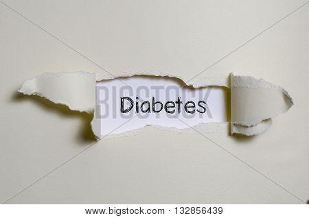 The word diabetes appearing behind torn paper.