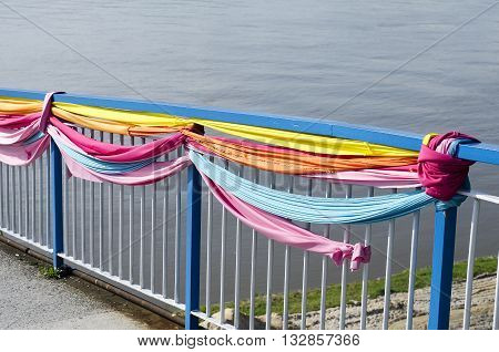 Old colorful handrail and river background .