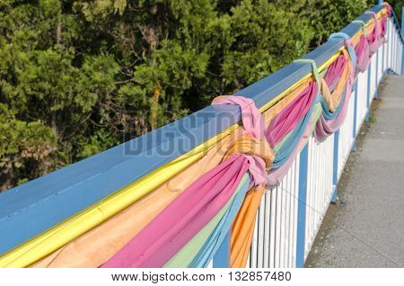Old colorful handrail and green background .