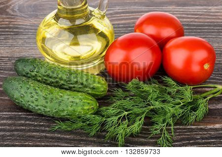 Bottle Of Oil, Tomatoes, Cucumbers And Dill