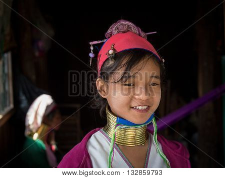 INLE LAKE MYANMAR - JANUARY 12 2016: Padaung Tribal woman poses for a photo in Inle lake Myanmar Burma The Padaung-Karen long-necked tribe women are minority of Myanmar.