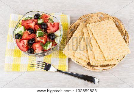 Vegetable Salad In Transparent Bowl, Fork And Crispbread In Basket