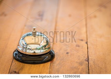 reception bell on wooden top background and wallpaper
