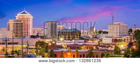 Montgomery, Alabama, USA downtown skyline at night.