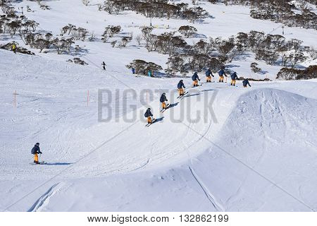 Skier racing and jumping through a Ski Cross Course - racing against the clock in Australia
