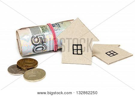Cardboard houses and the Russian money on a white background. Buying a property
