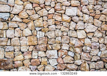 background of a wall made with irregular stones