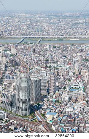 Vertical Japan Tokyo cityscape commercial and residential building road aerial view