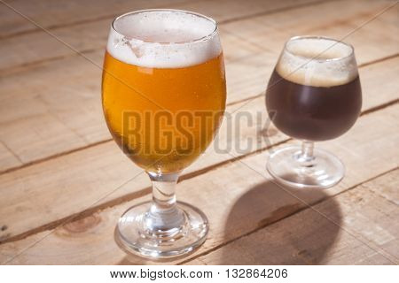 Dark And Light Beer On Wood