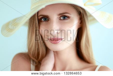 Portrait of beautiful model in hat , isolated on white background