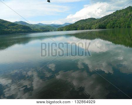 water mirror at the acumulation lake, Baraj Firiza, Maramures, Romania