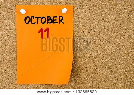 11 October Written On Orange Paper Note