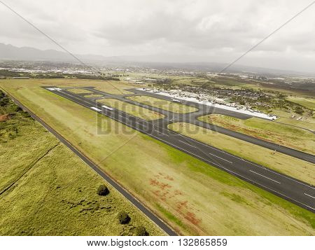 Aerial view of Hilo International Airport Runway, Hawaii with cloudy sky
