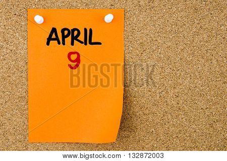 9 April Written On Orange Paper Note