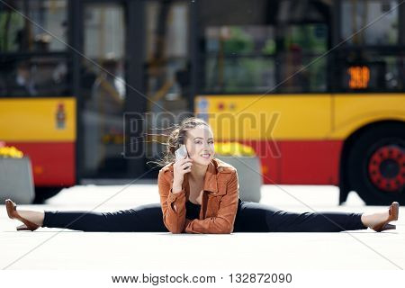 Acrobat using the phone in the city