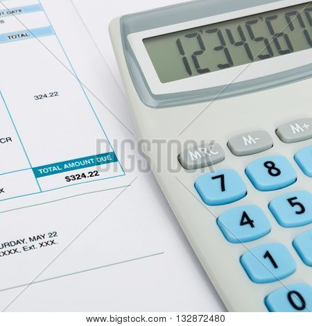 Unpaid Utility Bill And Calculator Over It