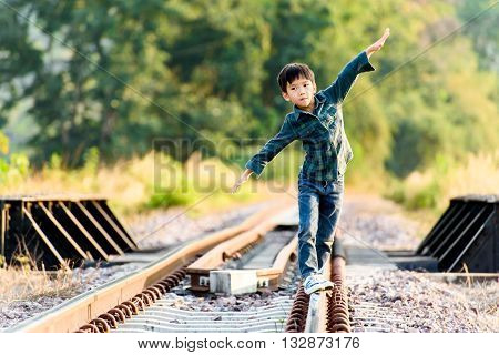 Boy Walk On The Railway