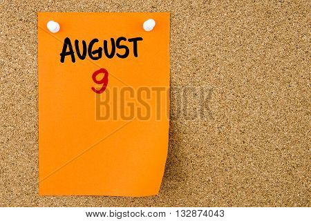 9 August Written On Orange Paper Note