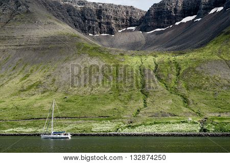Small yacht and scenic landscape near Reykjavik in Iceland.