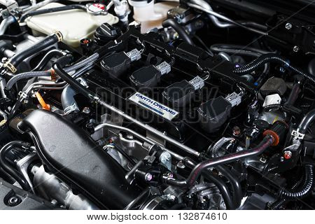 BANGKOK, THAILAND - MAY 20, 2016 : Closeup of engine in Honda Civic rs 2016 model, first available turbo charge engine from Honda in Thailand.