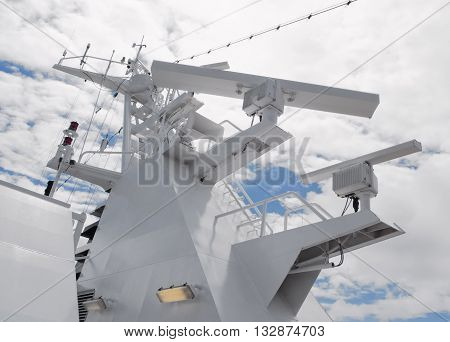 Close details of radar navigation system and communication tower.