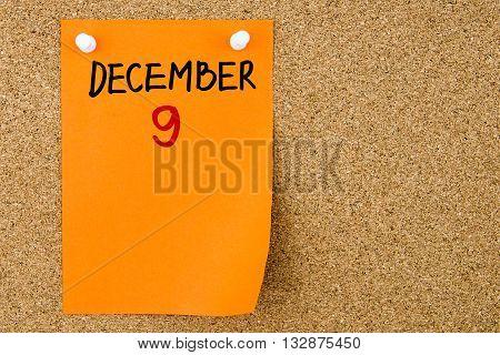 9 December Written On Orange Paper Note