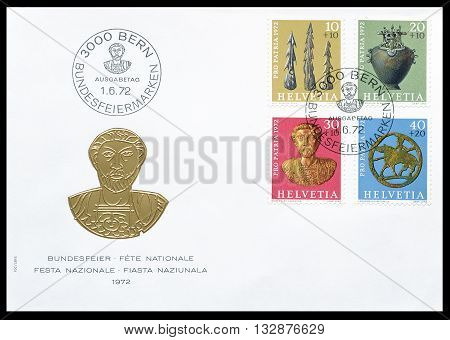 SWITZERLAND - CIRCA 1972 : First day cover letter printed by Switzerland, that shows museum artifacts.