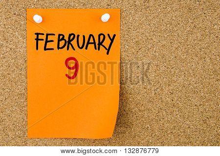 9 February Written On Orange Paper Note