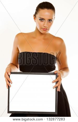 Pretty business woman at office desk pointing at a computer isolated a white background