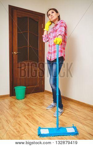 Wash the wood floor mop. Housekeeping concept