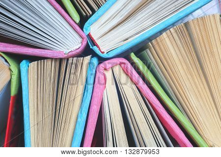 Old And Used Colorful Hardback Books Or Text Books Seen From Above.