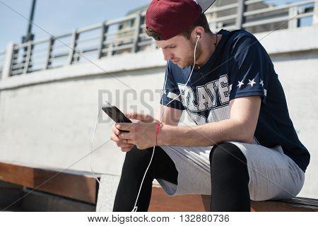 Man Using Mobile App During Running