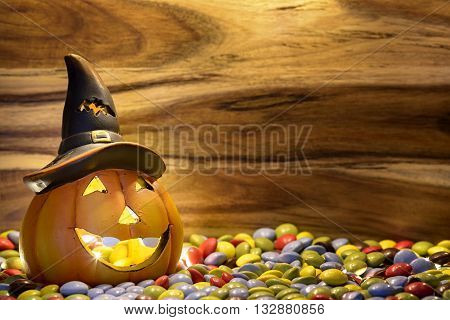 halloween pumpkin with chocolate candy in magic candlelight