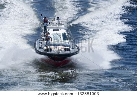 Rio de Janeiro, Brazil -  December 20, 2012: Pilot boat assisting large cruise ship with navigation in the waters of Rio de Janeiro