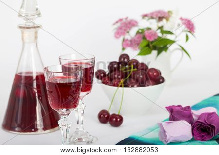 Celebration of Valentine day with cherry brandy and flowers