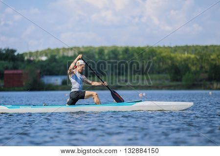 Chelyabinsk Russia - May 28 2016: muscular man athlete in a canoe rowing during Ural championship in rowing