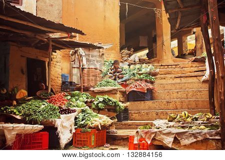 VARANASI, INDIA - JANUARY 2, 2016: Grunge walls of old vegetable and fruit market on stairs of indian city on January 2, 2016. Varanasi urban agglomeration had a population of 1,435,113