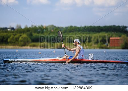 Chelyabinsk Russia - May 28 2016: man athlete rower on rowing kayak on lake during Ural championship in rowing
