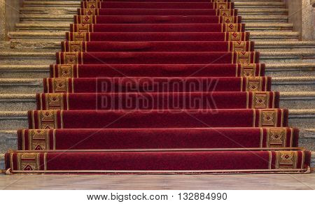 Red carpet on a stairway used to mark the route taken by heads of state vips and celebrities on ceremonial and formal occasions or events