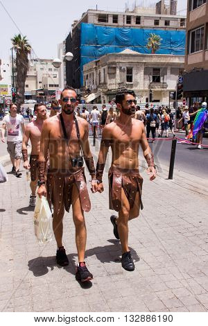 Tel Aviv Israel June 03 2016: Members of the traditional yearly pride parade surrounded by other people in Tel Aviv Israel
