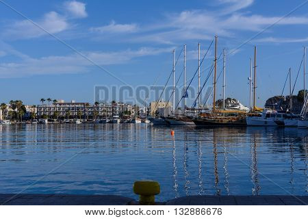 Early morning walking on the calm port of Kos Island.