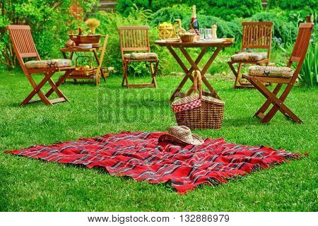 Picnic Blanket With Hat And Basket. Party Or Picnic Concept