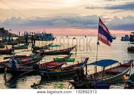 Sunset Over A Row Of Fishing Boats On Koh Tao Beach In Thailand