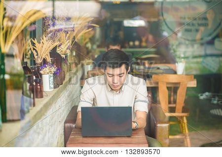 Handsome Young Asian Student Man Working On Laptop And Smiling