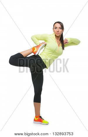 Beautiful sporty fit woman in sportwear making exercises. Isolated over white background. Copy space.