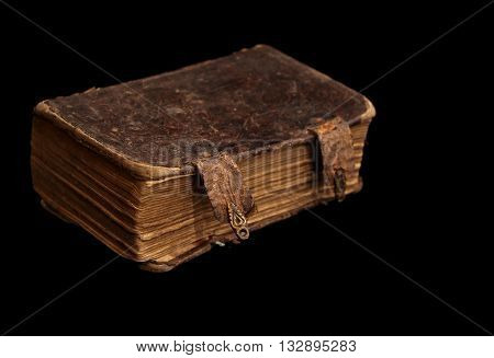 very old and shabby book in dark