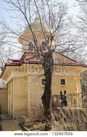 A small building behind the tree. Architecture and attractions of the city of Kislovodsk.