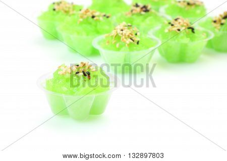 Single of group pandanus flavored sweet translucent gelatinous rice.